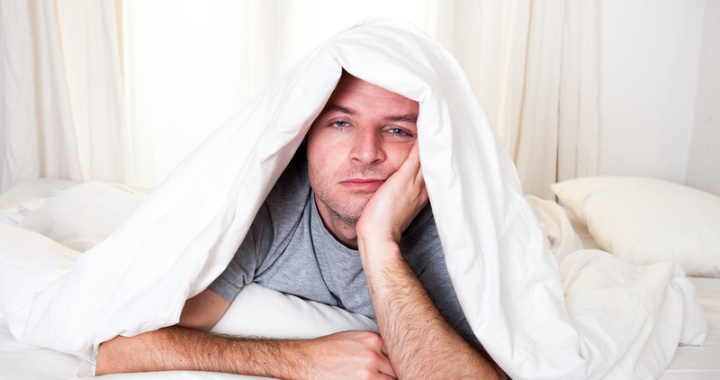 man having a bad sleepless night