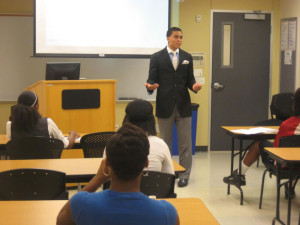"""Dr. Clarence Marcus Lee '04 BS leading a workshop at a youth camp in Austin, Texas. He spoke on the """"price of success."""""""