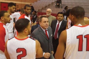 Head coach Ken Burmeister addresses the team during the Cardinals' game against Huston –Tillotson University this season.