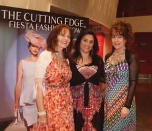 Harrell (left) poses with friends at Cutting Edge.