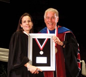 Dr. Louis Agnese, UIW president, presents Brune with the Alumni of Distinction award.