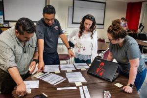 Dreeben PhD students, Mark Alvarez, (left) Jaime Gonzalez, Linda Gjergji and Eryanne Taft work together on systemization assignment in Qualitative Methods and Analysis interdisciplinary class.