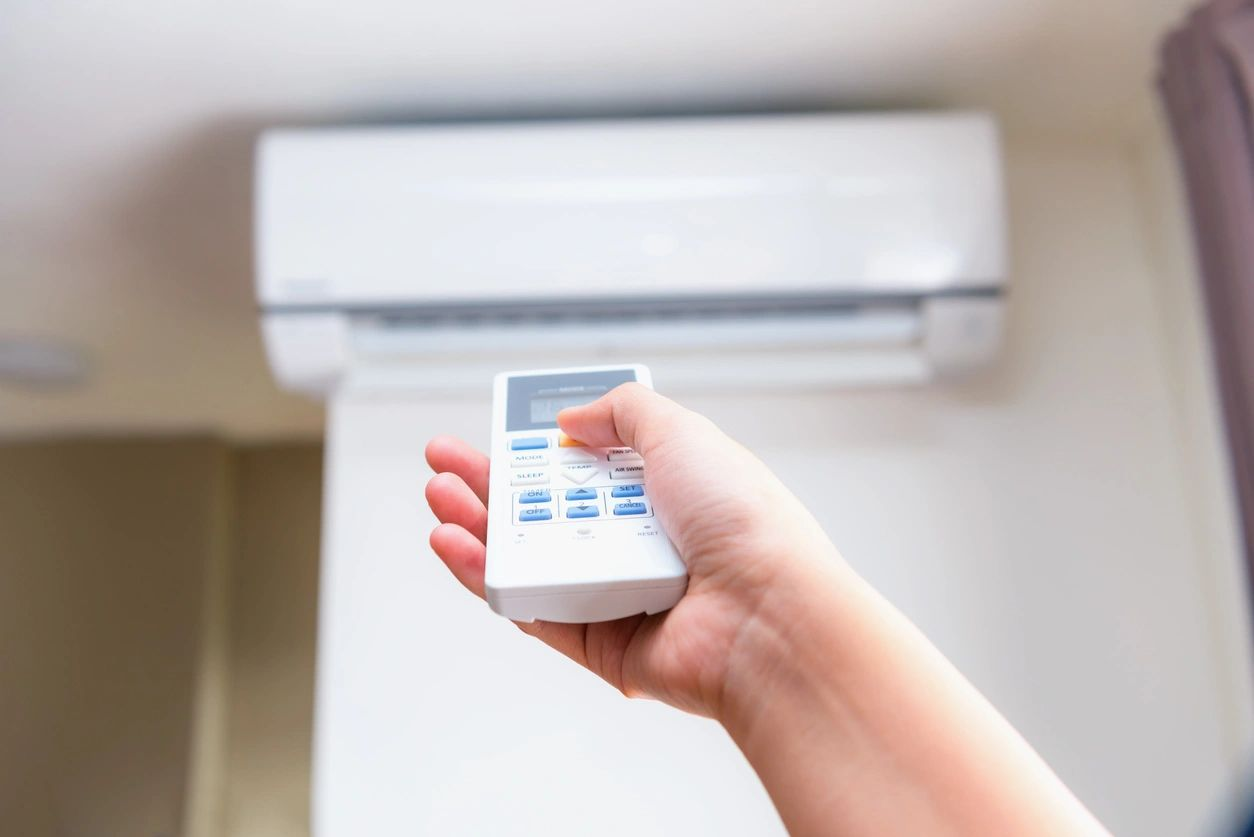 remote pointing towards air conditioning unit