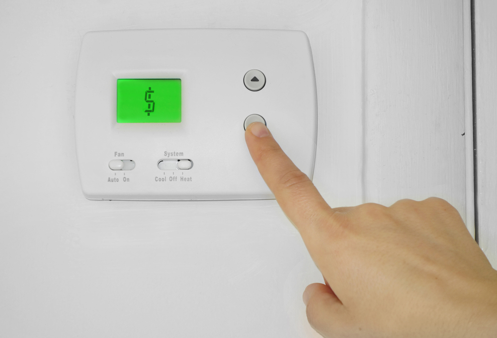 AC thermostat with a dollar sign