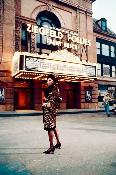 American actress and singer Barbra Streisand stands outside a theater 2