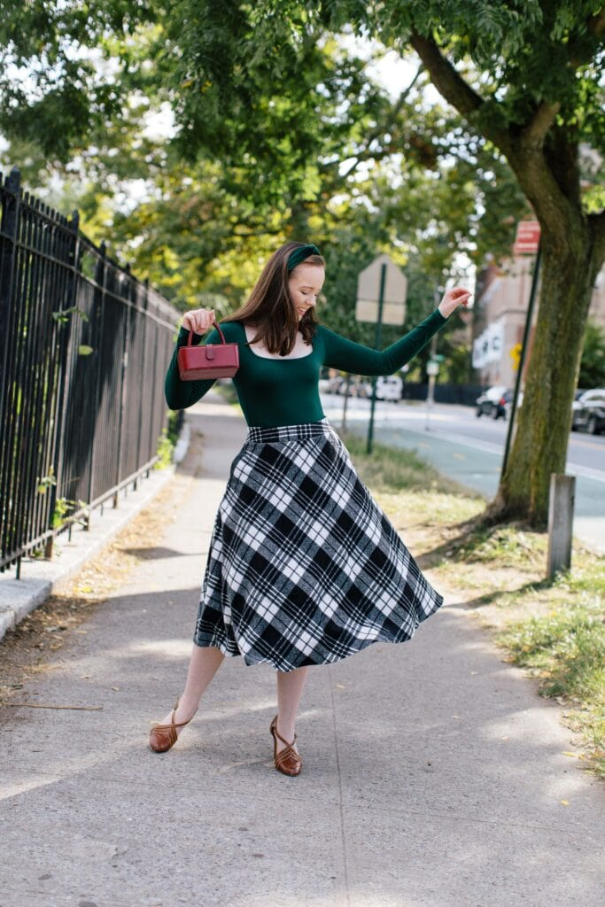 Woman in green and plaid 1940s inspired clothing