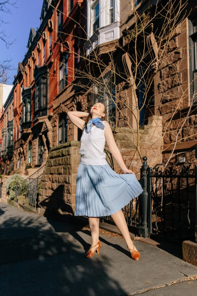 Woman in vintage style fashion using Singing in the Rain inspiration