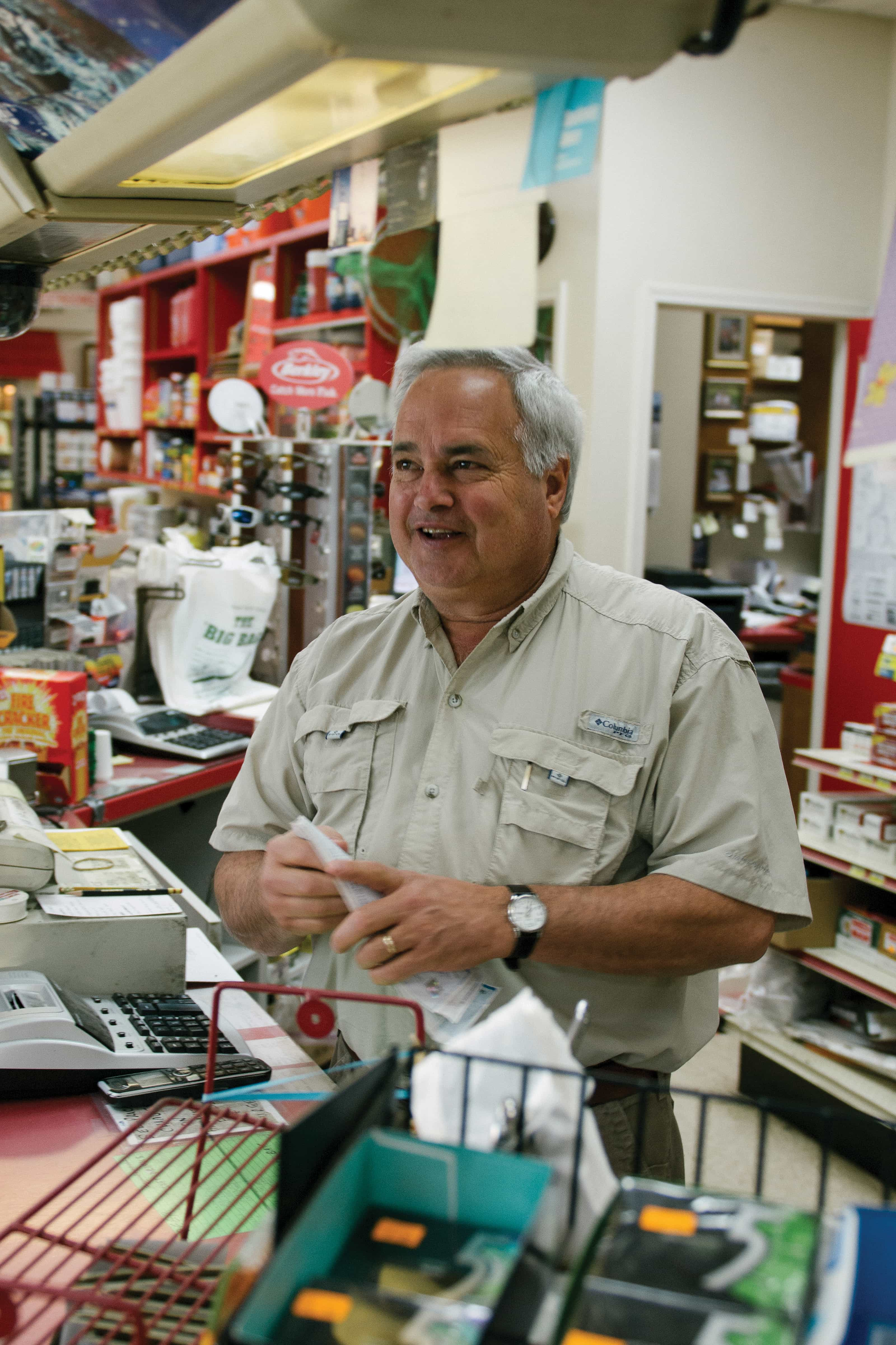 Mark Fratesi laughs while talking to a regular customer.