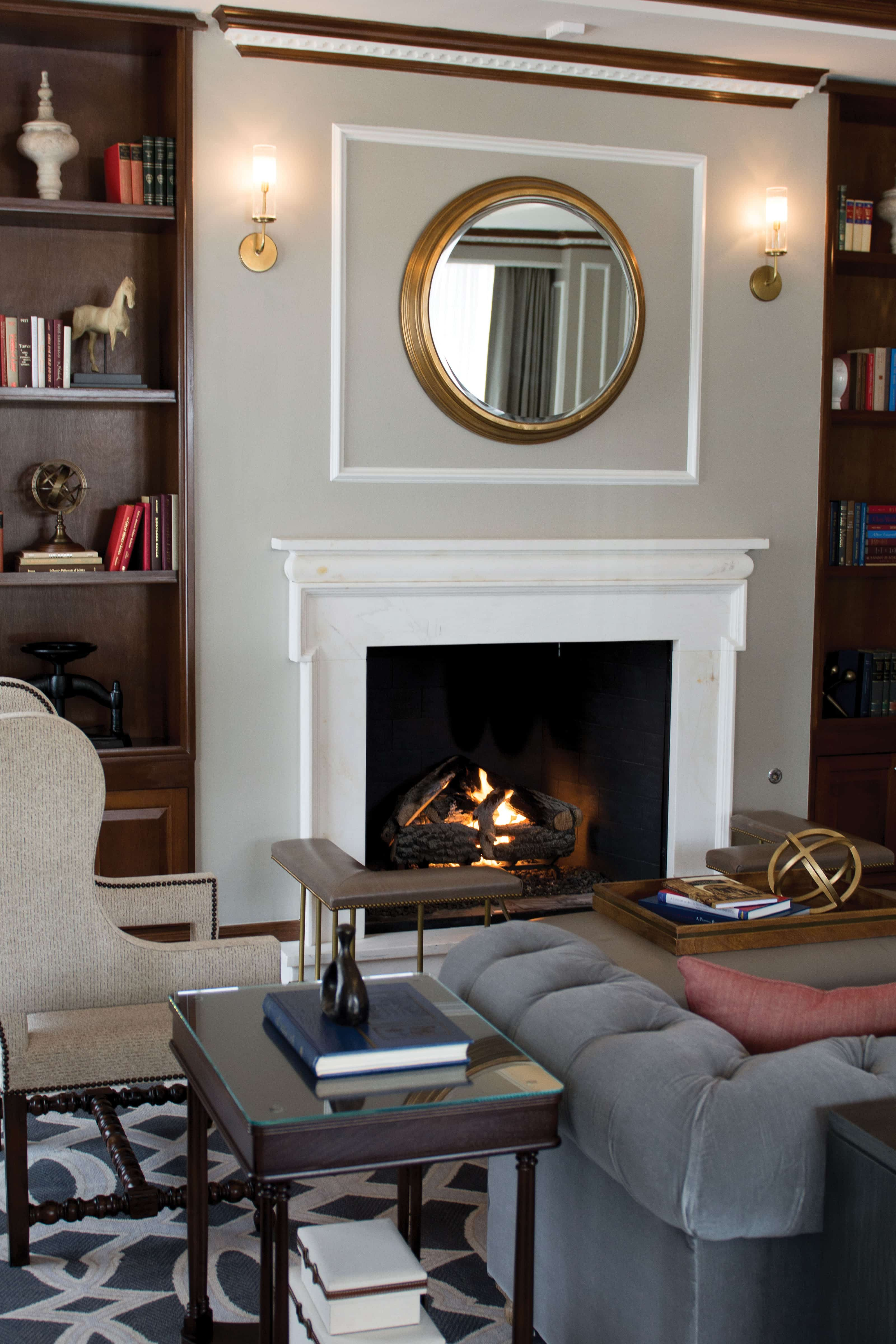 The study/lounge features a fireplace and bookshelves for guests to enjoy.