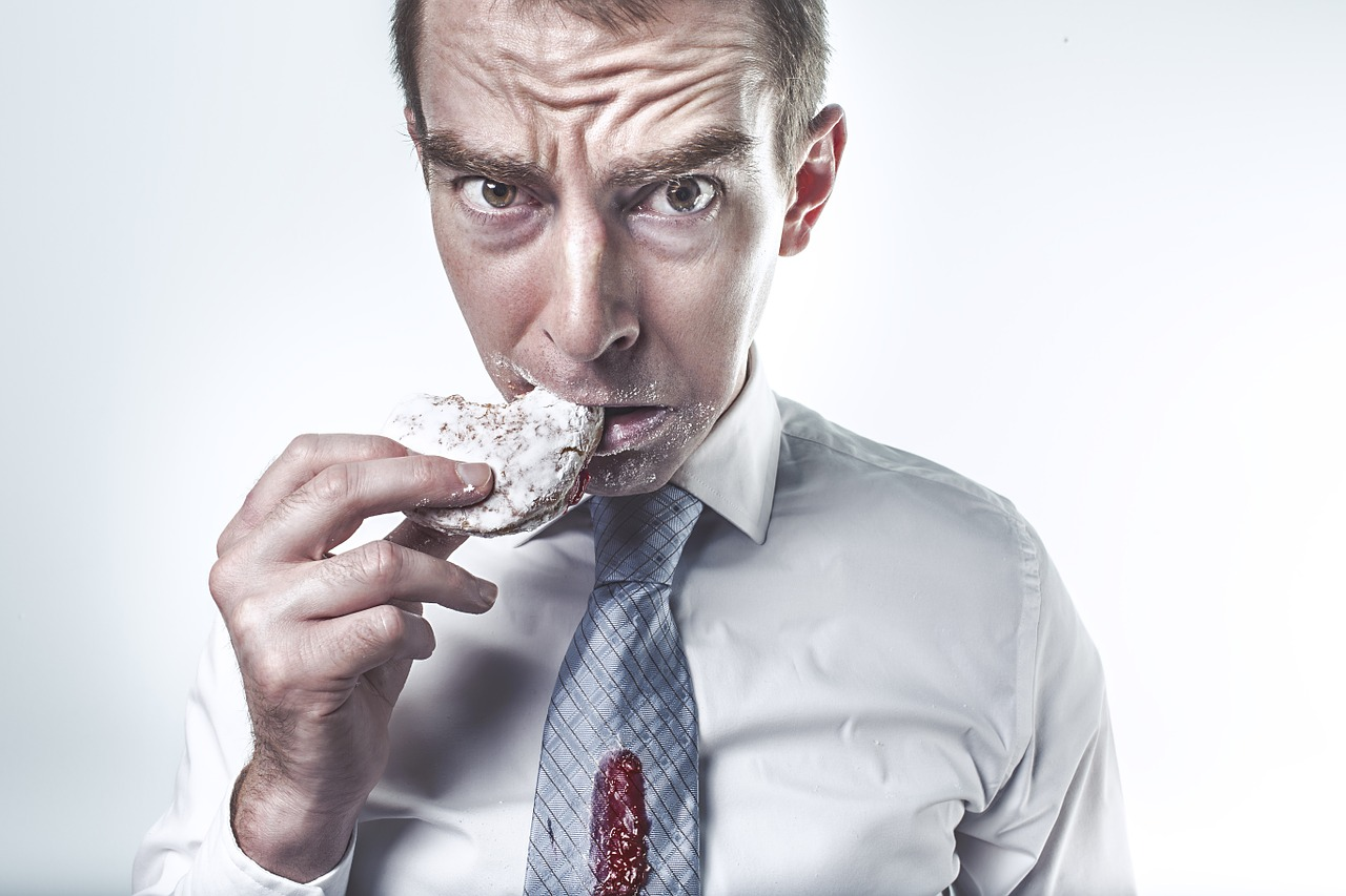Man eating doughnut