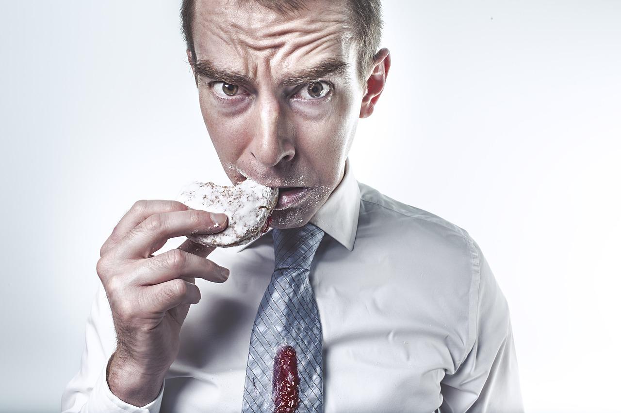 Man eating doughnut