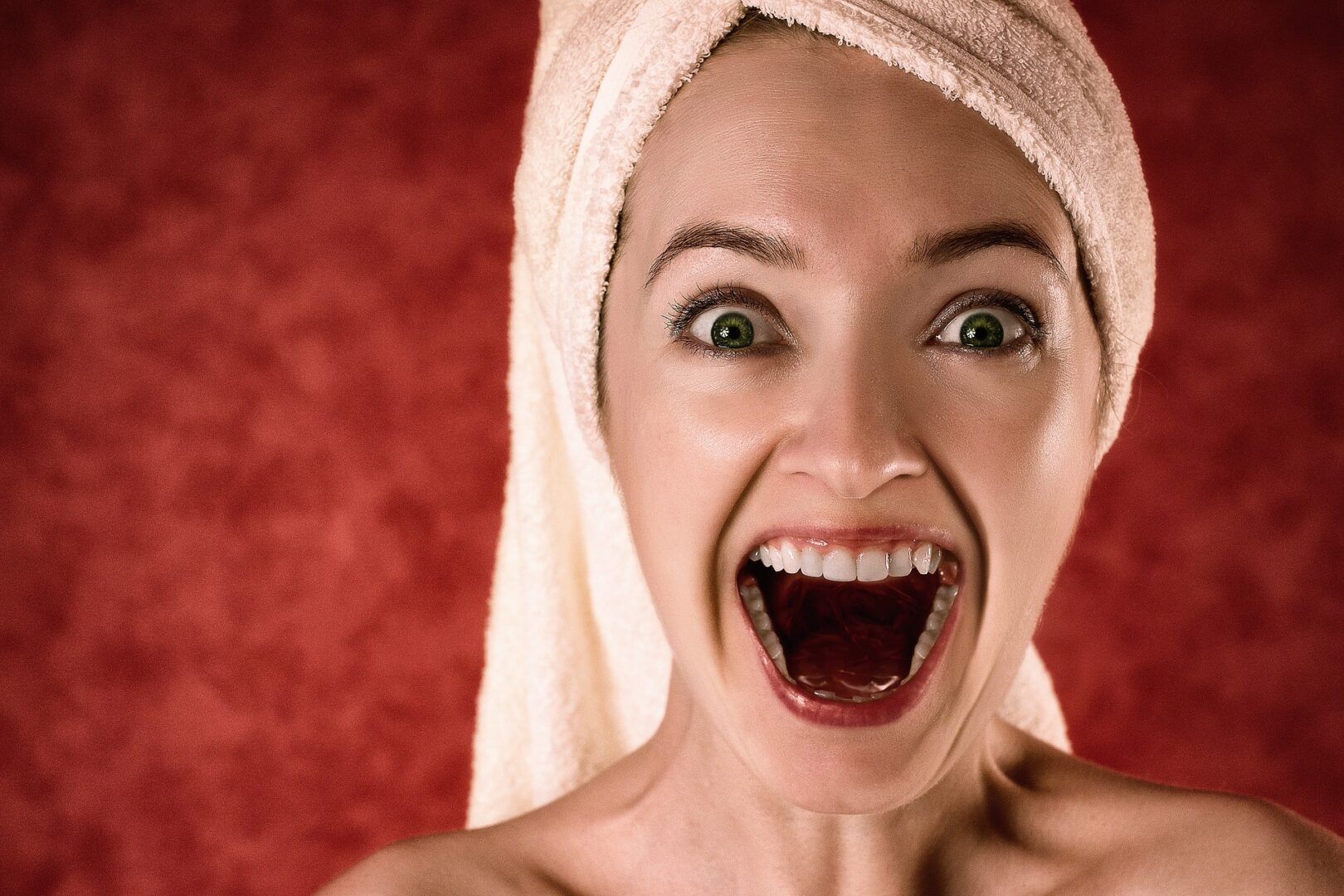 Woman with towel on her head screeming