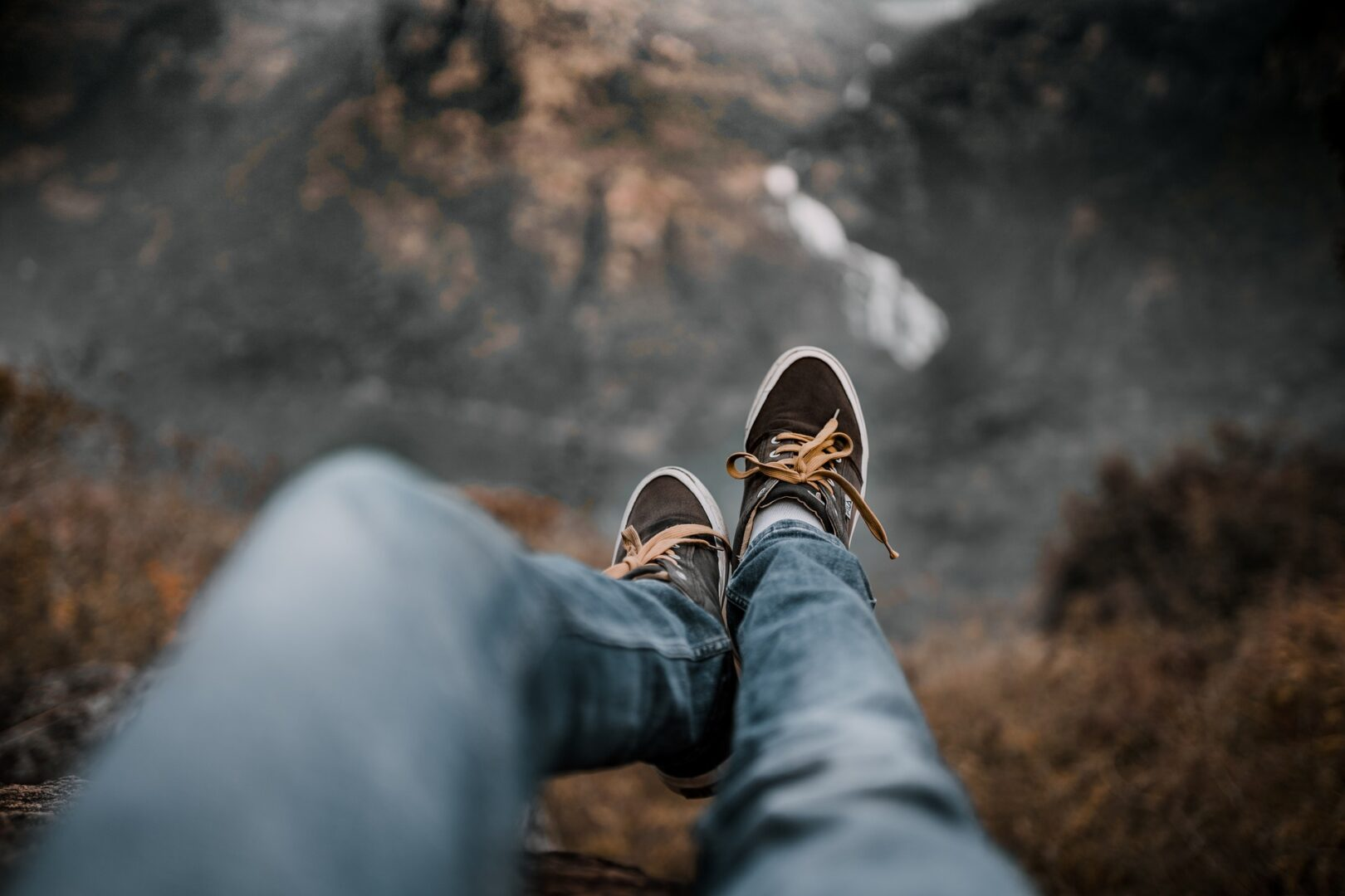 Feet over the edge of a cliff
