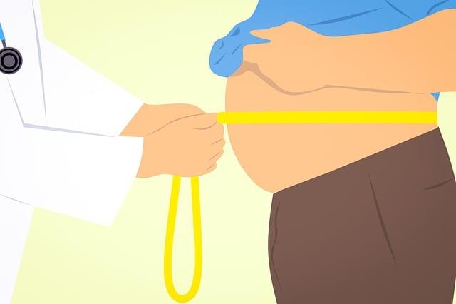 Doctor measuring a man's waist