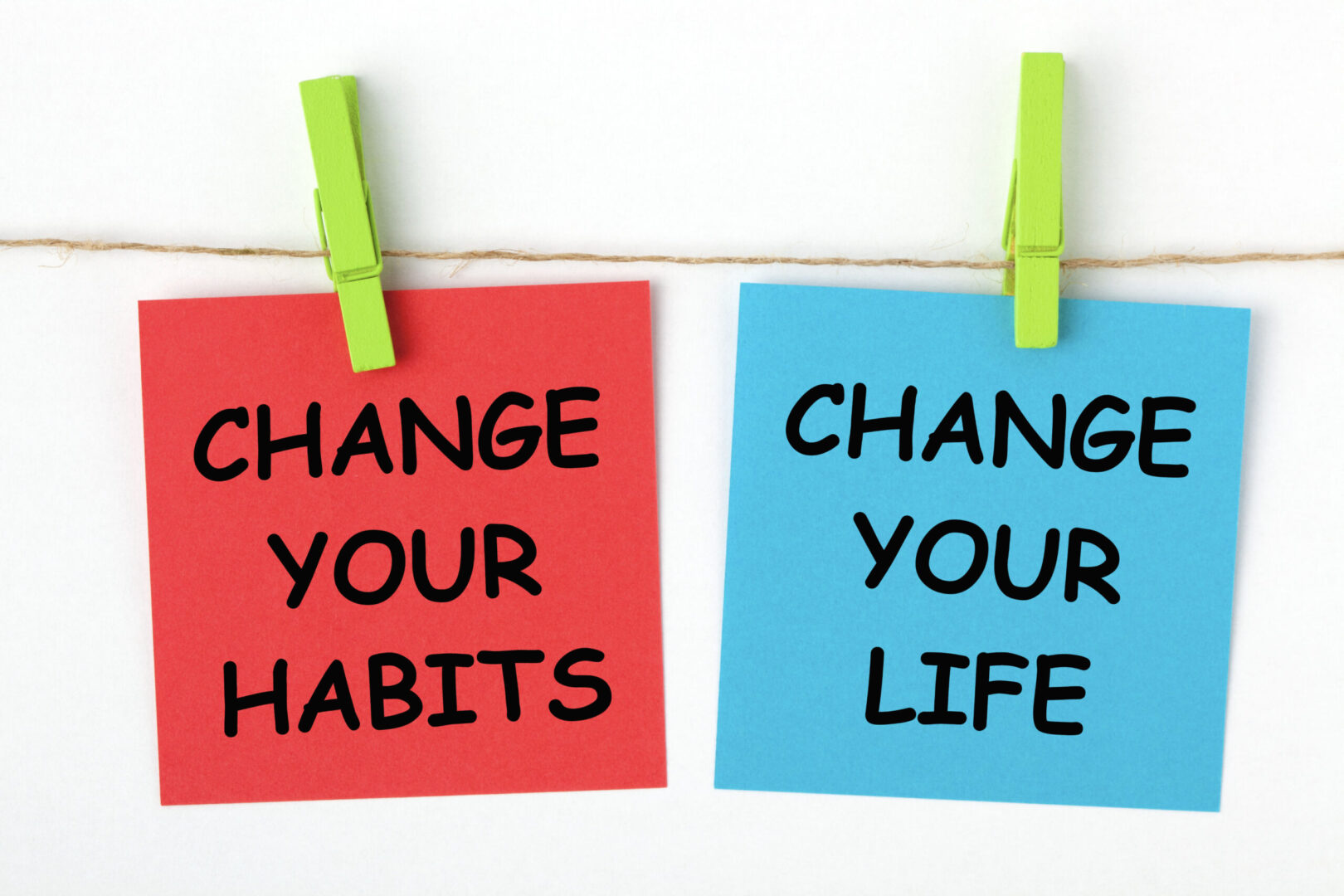 Change your Habits Change you Life post its on a clothes hanger