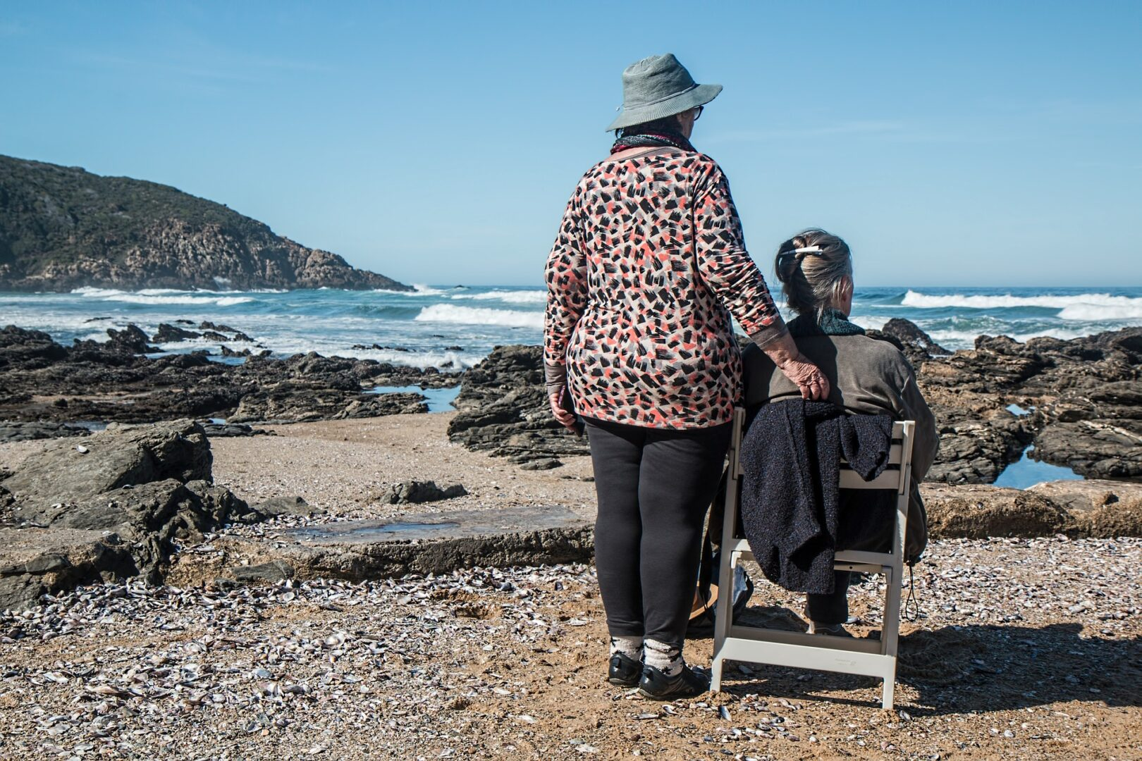 two women looking out at the sea