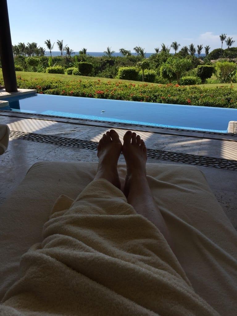 Feet under a blanket poolside