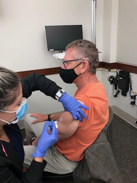 Dr. Feaster receiving his COVID vaccine
