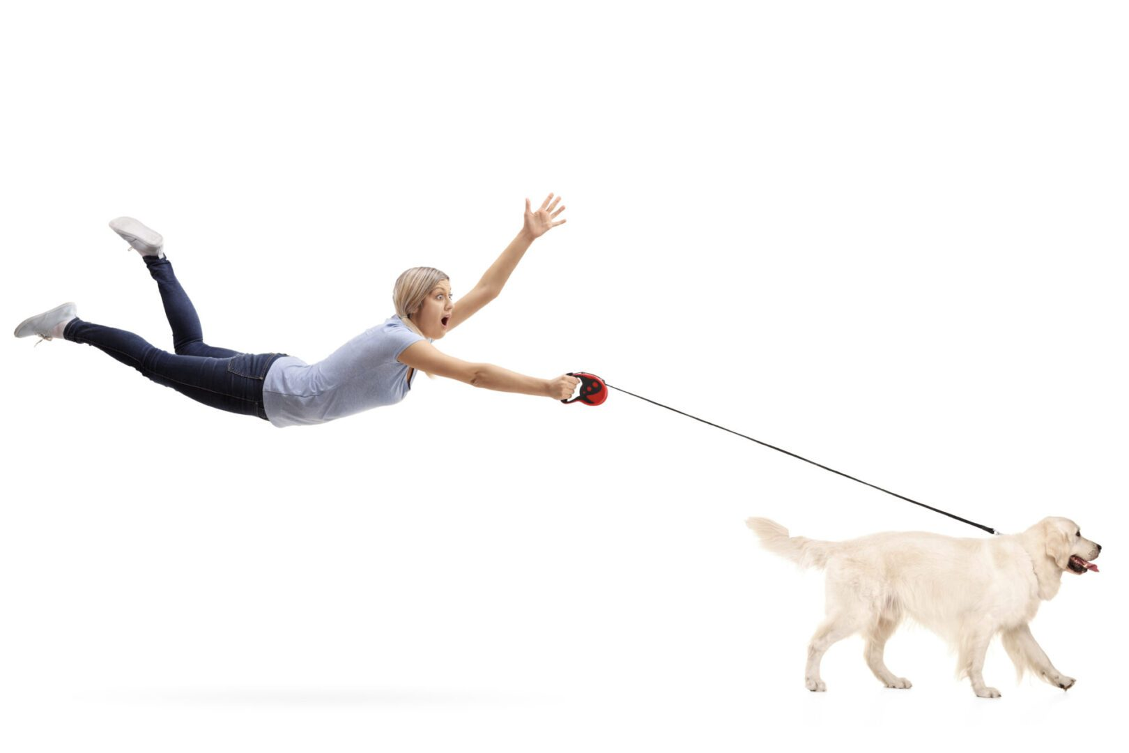 Woman flying with leash in hand and dog running