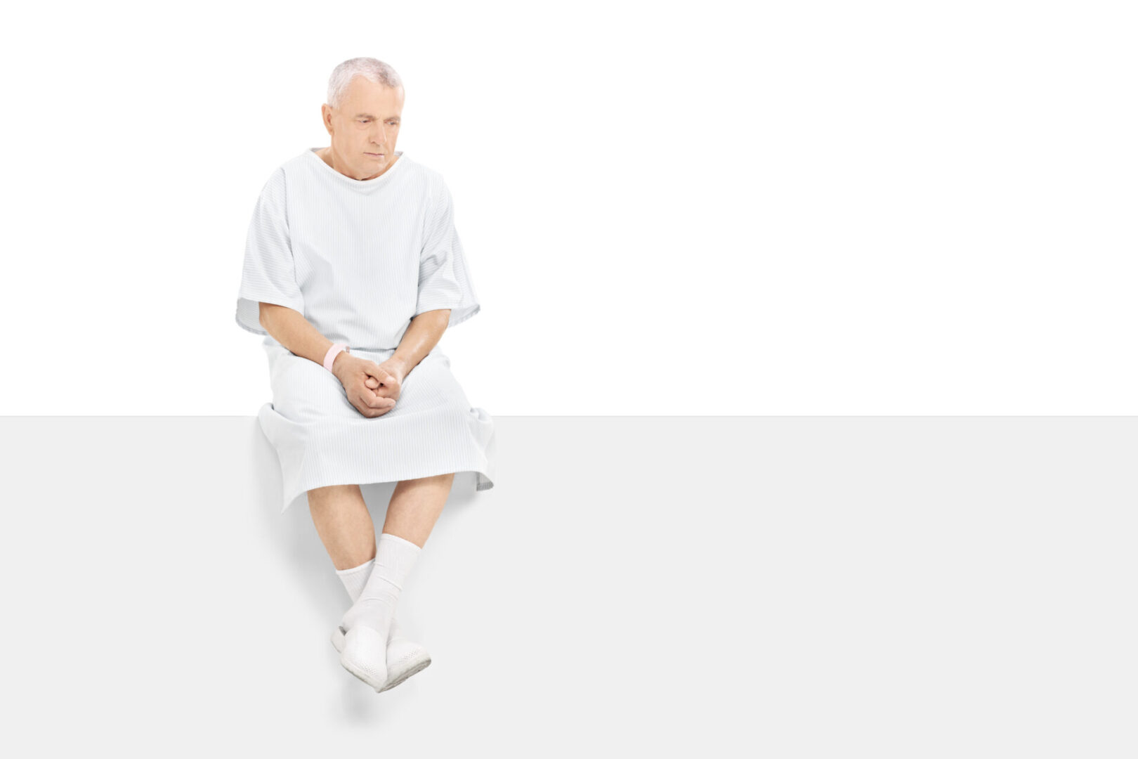 Man sitting in patient gown