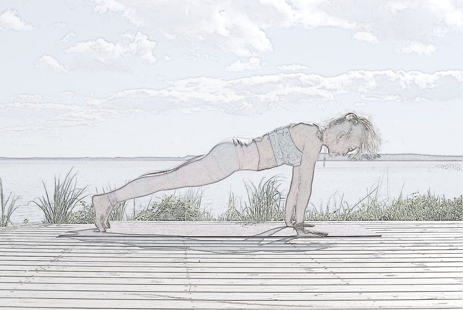 Woman doing a plank on a deck in front of water