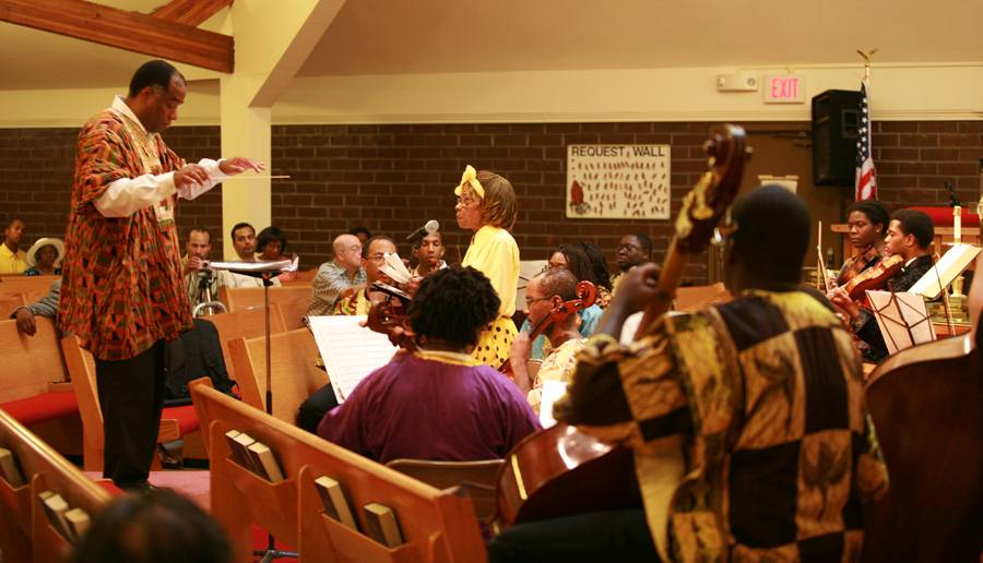 Michael Simpson, conductor, Reverend VerniceWarfield, narrator and strings