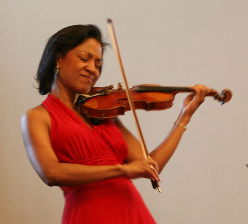"""Kelly Hall-Tompkins performed Claude Debussy's """"Sonata for Violin and Piano,"""" accompanied by pianist Terrence Wilson"""