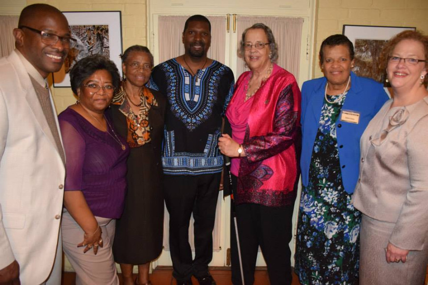 Amadi Azikiwe with Benefit Committee members, l-r:  Rev. Ricky Frazier, Jackie Ulmer, Marie Rivers, Amadi Azikiwe, Carolyne Blount, Dolores Orman and Ruth Phinney. Not pictured: Stella Rainge.