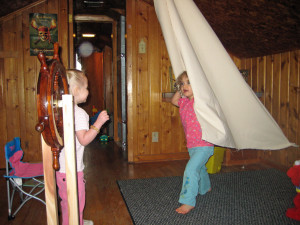 The attic. Here is my daughter and her friend playing in the pirate ship playroom I made for her (complete with canvas sail and freestanding ship's wheel). This is the room my brother slept in. Once.