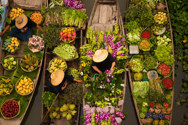aerial-view-of-a-floating-market-on-a-canal-in-ban-YEACEFN