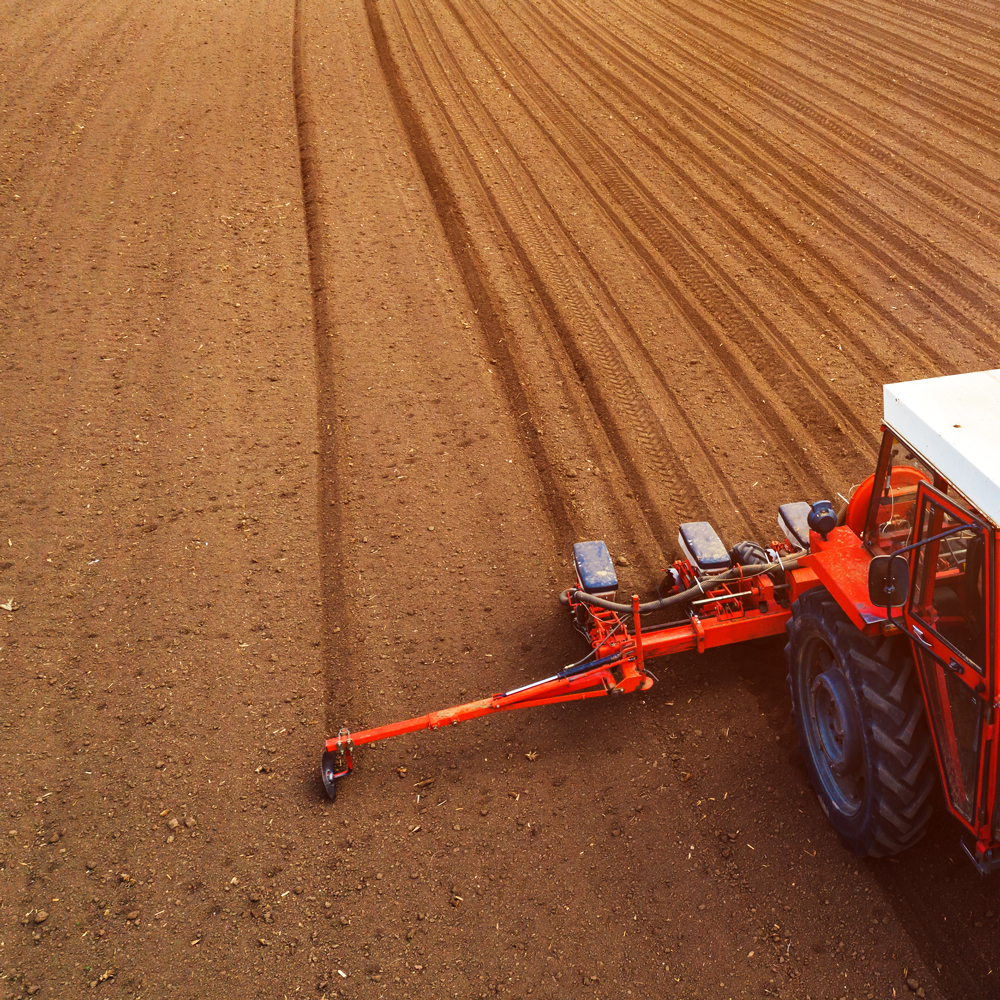 aerial-view-of-tractor-with-mounted-seeder-perform-compressed