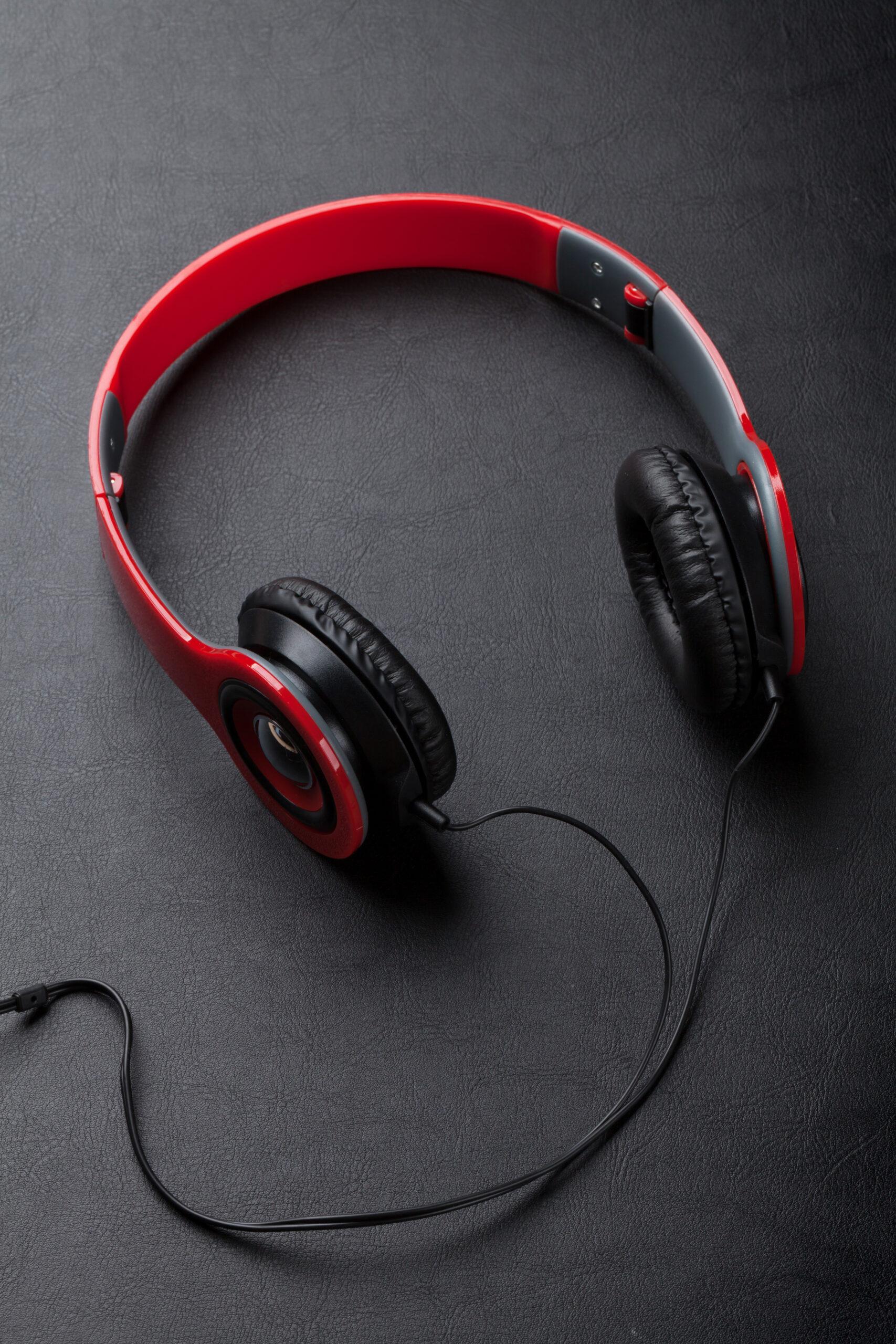 Headphones on black leather desk table