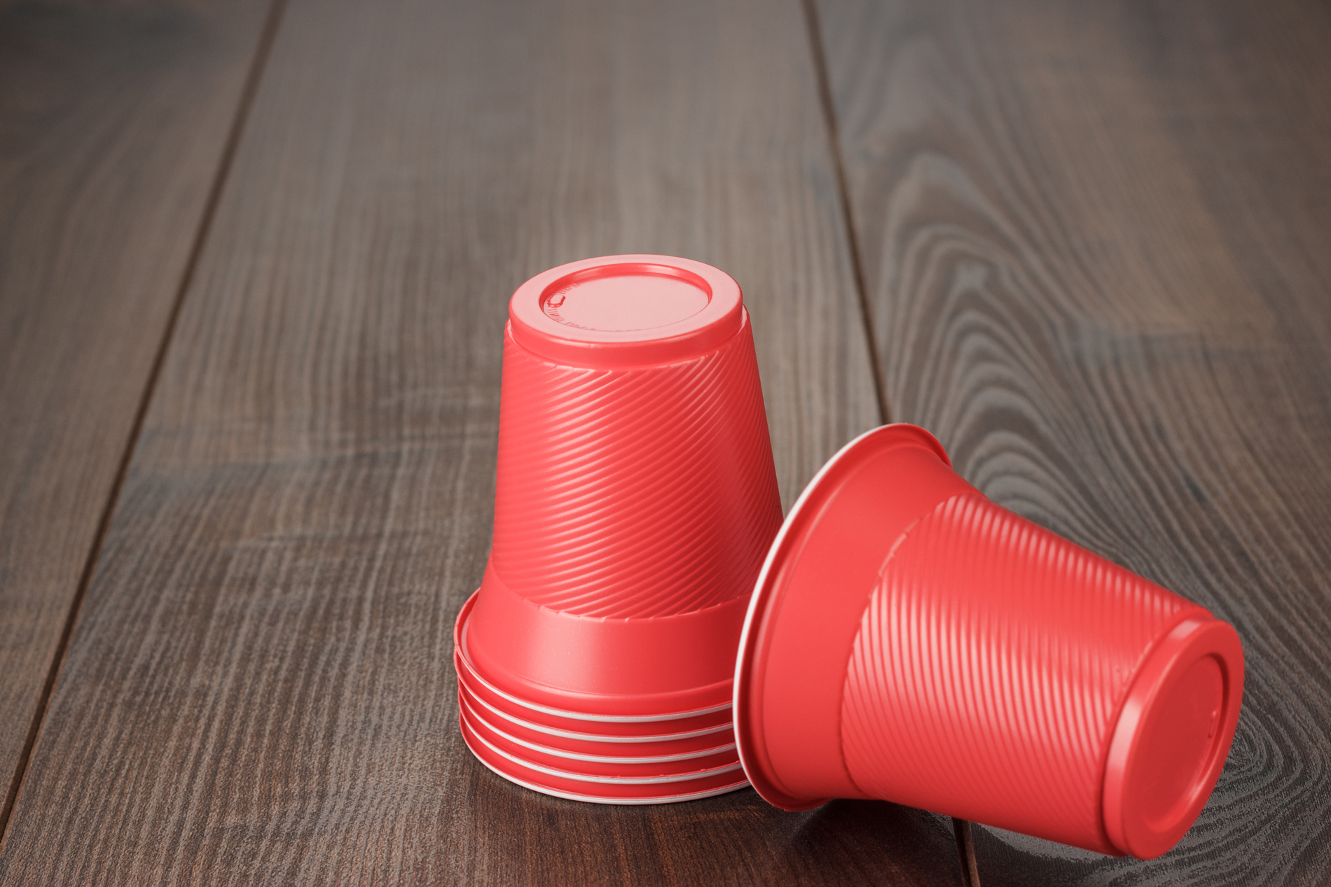 stack-of-red-plastic-cups-on-the-table-compressed