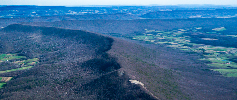 The circular scar on top of Evitt's Mountain was a clearing for a test tower when Iberdrola planned to build a wind project in 2006.