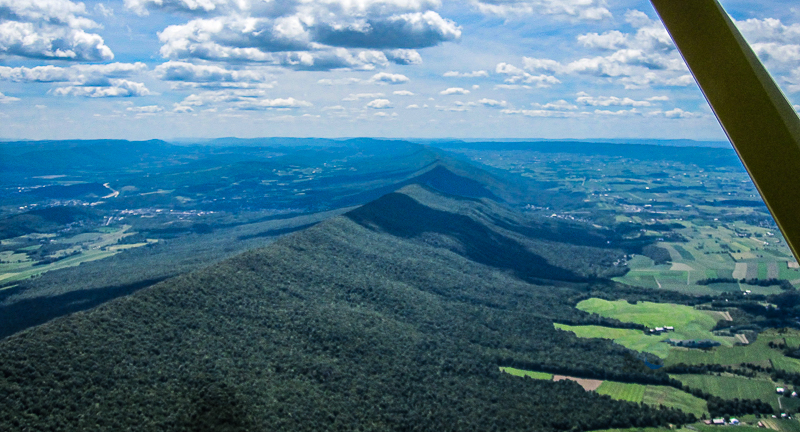 Jacks Mountain is beloved by hang gliders and sailplane pilots, as well as raptors, which use its winds for migration.  It's narrow, rocky summit is ill-suited for wind projects.  Credit:  Beth Reifsnyder