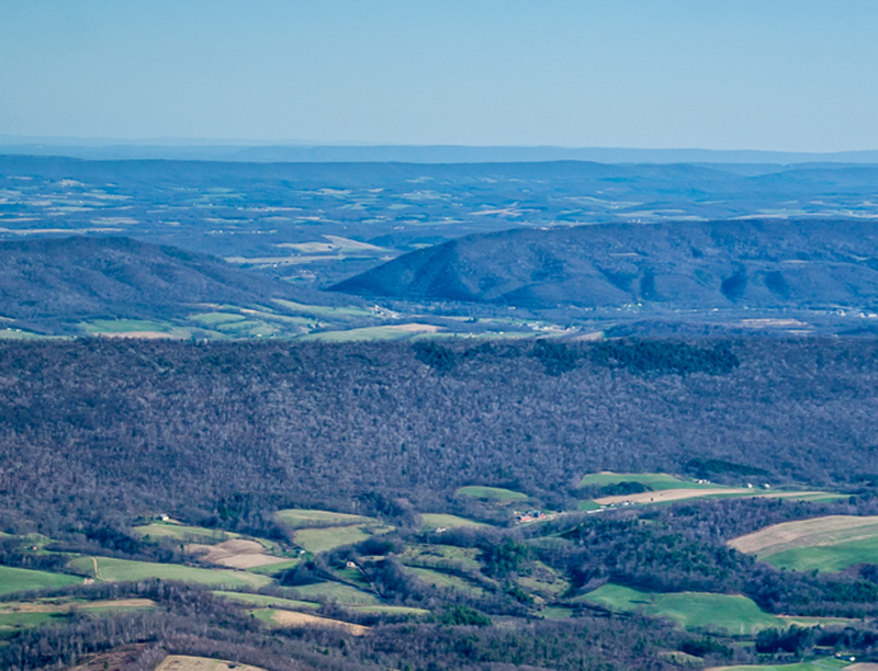 A small part of Dutch Corner (foreground) is shown with Dunning/Evitt's Mountain forming an impressive backdrop.  A portion of Tussey Mountain is shown in the background.