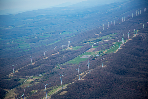 Wind turbine setbacks should be regulated with consideration of safety and noise concerns.