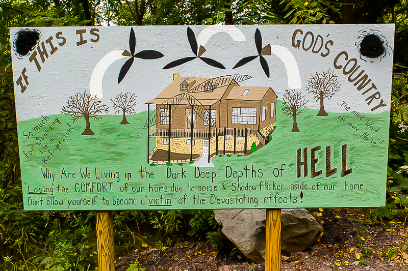 This hand-painted sign in Somerset County shows that wind turbines sited too close to homes can ruin peoples' lives.