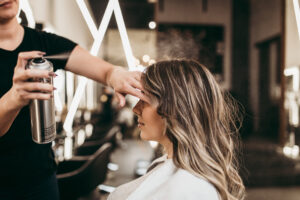 Woman at Hair Salon getting hair done by stylist