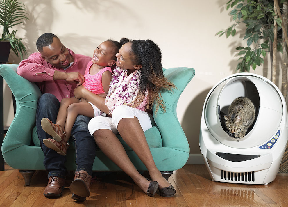 Family enjoys time while cat uses the Litter-Robot