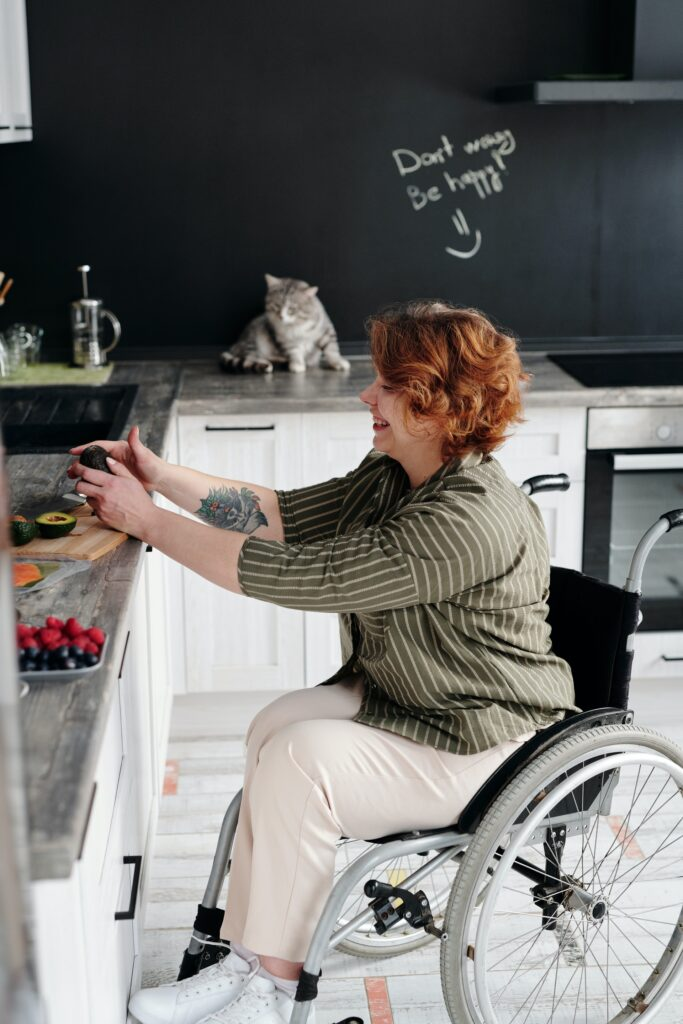 Photo: Woman using wheelchair in kitchen