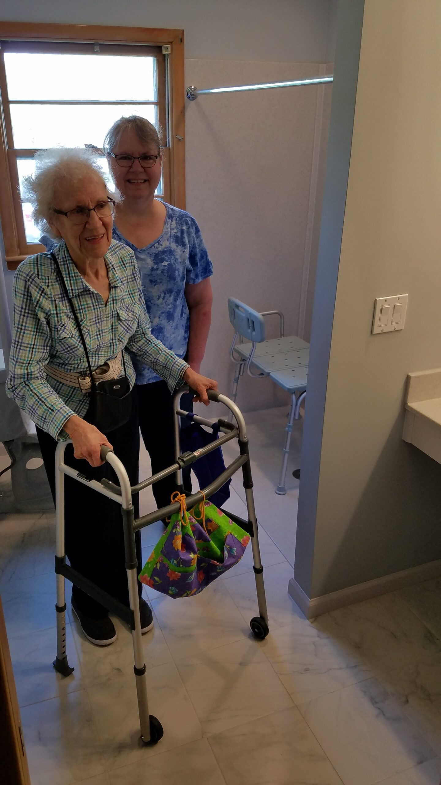 Photo: Mrs. Fullerton with her mom checking out her new shower