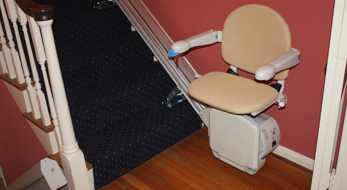 Photo: Stair lift for limited mobility installed by Accessibility Remodeling