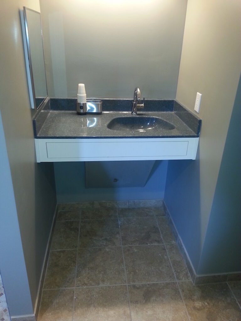 Photo: Vanity with space for chair underneath by Accessibility Remodeling