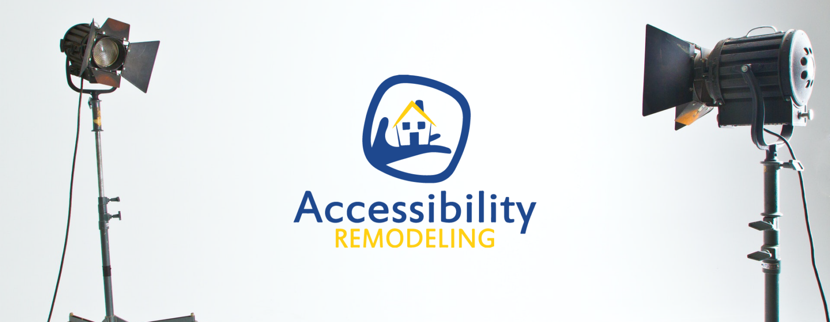Two spotlights focused on the Accessibility Remodeling logo