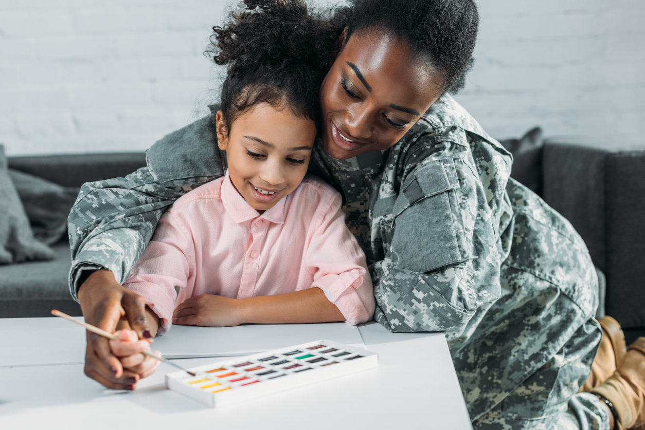 Military Mom with daughter doing a watercolor painting