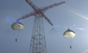 250 Foot Tower, two trainnies jumping with parachutes