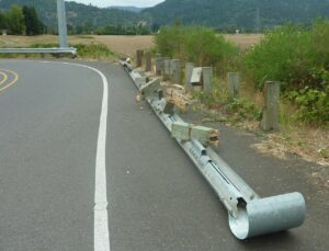 A damaged crash barrier along a roadway