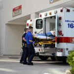 paramedics unloading a patient from an ambulance