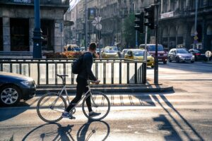 A cyclist in a road waiting for a traffic signal